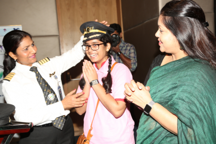 Captain Nivedita awards a WAI student with a pilot cap.