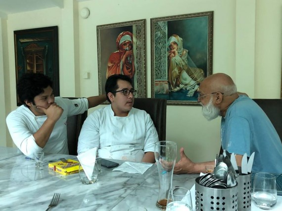 Professor Pushpesh Pant talking to young chefs at Indus, Bangkok.